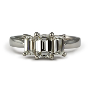 Emerald cut diamond trilogy ring